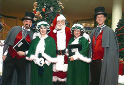 A Caroling Company costumed victorian singers with Santa at Rosedale Center Mall, Minnesota